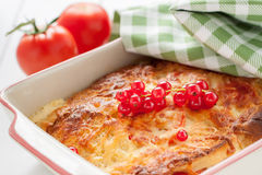 Bread pudding with cheese and tomatoes Stock Images