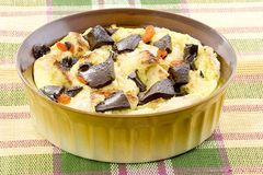 Bread pudding with chocolate. Bread pudding made with french bread, try adding chocolate chunks and dried apricots to this comfort food royalty free stock photos
