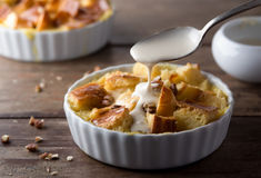 Bread Pudding with Cream Sauce Stock Photos