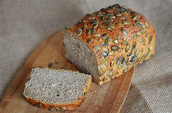 Bread with pumpkin seeds. Pumpkin bread with seeds cut Royalty Free Stock Photo