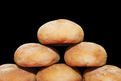 Bread pyramid. Home-made pyramid on a black background Royalty Free Stock Photo