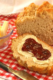 Bread and Raspberry Jam. Slice of rustic bread with butter and raspberry jam Stock Photo