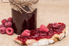 Bread with Raspberry Jam (rustic background). Bread with Raspberry Jam and fresh fruits on rustic background Stock Photo