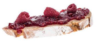 Bread with Raspberry Jam on white Royalty Free Stock Image