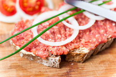 Bread with raw beef Stock Image