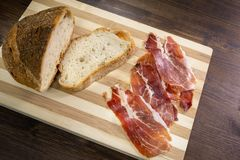 Bread and raw ham, a perfect match. All ready for a good sandwich Royalty Free Stock Photos