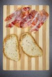Bread and raw ham, a perfect match. All ready for a good sandwich Royalty Free Stock Image