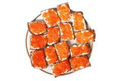 Bread with red caviar Stock Photos