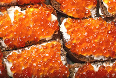 Bread with red caviar Royalty Free Stock Photos