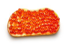 Bread with red caviar Stock Photography