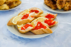 Bread with red caviar Stock Photo