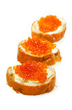 Bread with red salmon caviar stock images