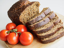 Bread and red tomatoes Stock Photo