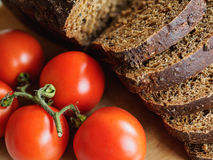 Bread and red tomatoes Royalty Free Stock Images