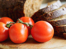 Bread and red tomatoes Stock Photos
