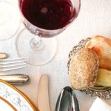 Bread and red wine. Luxury table setting with bread and red wine Stock Image