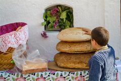 The bread for religious holidays, in Olympos, Karpathos Island, Greece. For religious holidays, the bread is blessed and cut into small pieces that the devotees Royalty Free Stock Image