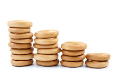 Bread-rings columns. Isolated on the white background Royalty Free Stock Images