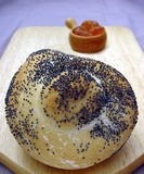 Bread Roll. With spread on chopping board stock photos