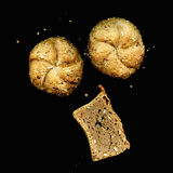 Bread roll and bread with seeds on a black background Stock Image