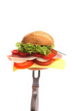 Bread roll for breakfast on a fork Royalty Free Stock Images