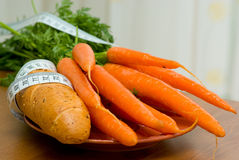 Bread roll and carrot Royalty Free Stock Photography
