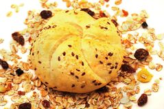 Bread roll and cereals. Bread roll with seeds and cereals on white background Stock Image