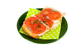 Bread roll with chicken and tomatoes Stock Photography