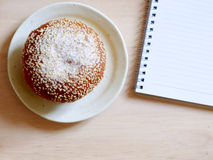 Bread roll covered with sesame seeds, typical breakfast food. Studio shot. Stock Photography