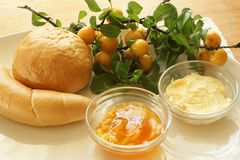Bread roll and croissant with yellow plum jam Royalty Free Stock Photo