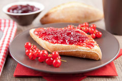Bread roll with jam Royalty Free Stock Photography