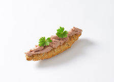 Bread roll with pate Stock Photography