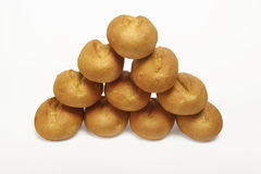 Bread roll pyramide. Pyramid made out of ten wheat buns on a white background Stock Photos