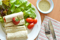 Bread roll and salad dipping sauce for breakfast Royalty Free Stock Photography