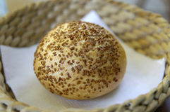 Bread roll with sesame seeds. Sitting in a basket Royalty Free Stock Photos
