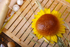 Bread roll and sunflower Royalty Free Stock Images