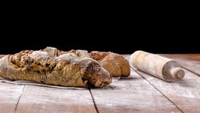 Bread with Roller on wood table with black background Stock Photo