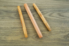 Bread Rollers on Aged White Ash Boards Stock Photography