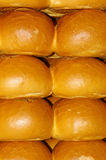 Bread Rolls 01. Layers of freshly baked bread rolls on a bakery counter of a market stall Royalty Free Stock Images