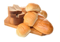 Bread and rolls. Black bread and rolls lay on a table Royalty Free Stock Photo