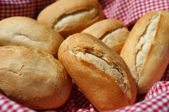 Bread rolls in basket. Small bread rolls in basket, lined with red and white cloth Royalty Free Stock Images