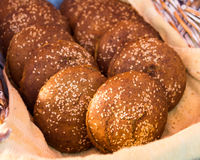 Bread or rolls in basket Stock Images
