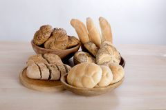 Bread rolls in the bowl. Many kinds of fresh pastries in a bowl Stock Photos
