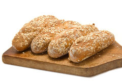 Bread rolls on breadboard Royalty Free Stock Images