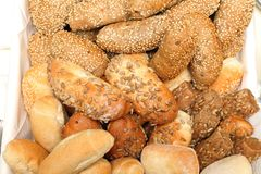 Bread Rolls. Bread Buns Rolls With Mix Seeds in Basket royalty free stock image