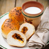 Bread Rolls Filled with Pumpkin and Feta with a Cup of Milk Stock Photo