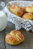 Bread rolls. Fresh homemade bread rolls with sesame seeds and milk Stock Photo