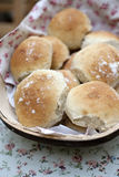 Bread rolls. Freshly baked bread rolls in a wooden bowl royalty free stock images