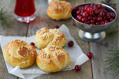 Bread rolls. Homemade bread rolls with sesame seeds and cranberry Royalty Free Stock Images