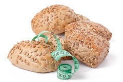 Bread rolls with measuring tape Stock Photography
